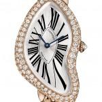 Montre Cartier Crash Or rose et lunette en diamants